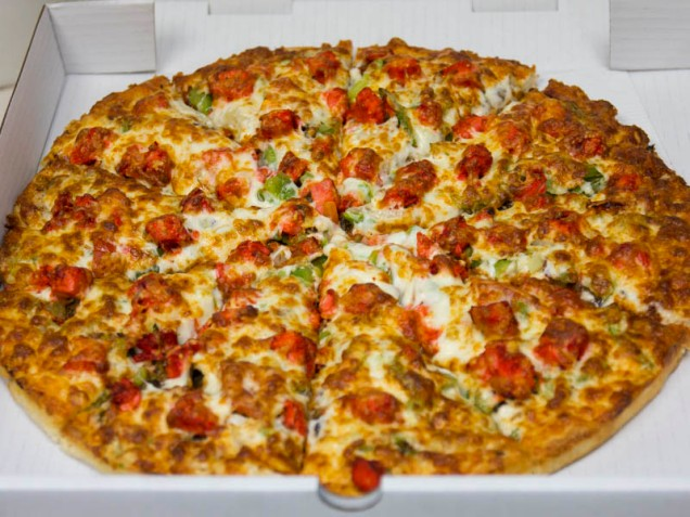 Our famous Tandoori Chicken Pizza